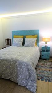 A bed or beds in a room at Casinhas da Ajuda nº25