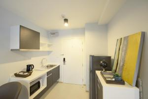 A kitchen or kitchenette at Zcape3 Phuket by Chirapas