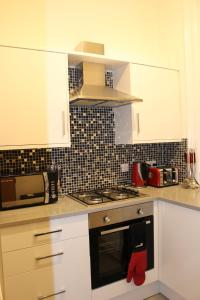 A kitchen or kitchenette at Angel Apartments - Islington