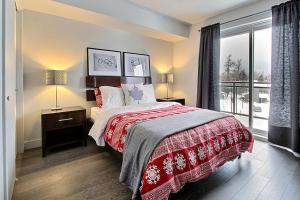 Un ou plusieurs lits dans un hébergement de l'établissement 3 Bedroom Condo in Mont Saint Anne
