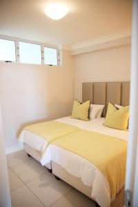 A bed or beds in a room at In Touch Seaview