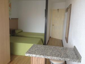 A bed or beds in a room at Apartamentos Koka