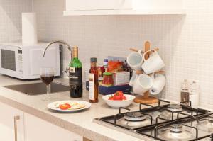 A kitchen or kitchenette at Savage Gardens