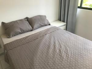A bed or beds in a room at flat parque jaqueira