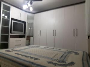 A bed or beds in a room at Apartamento no centro de Torres !!!!