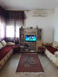 A television and/or entertainment center at Villa Mymy