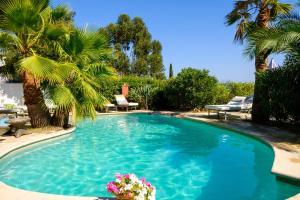The swimming pool at or near Le Hameau
