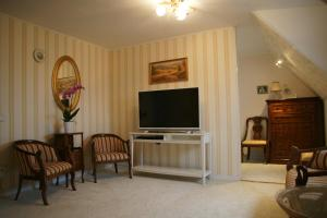 A television and/or entertainment center at Apartment Elena