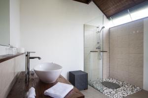 A bathroom at Medewi Snaffl Beach Villa