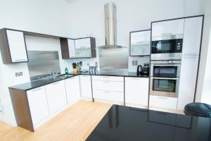 A kitchen or kitchenette at Ocean Serviced Apartments