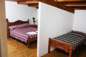 Una cama o camas en una habitación de Posadas Cayasta