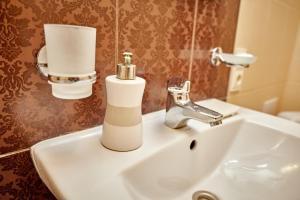 A bathroom at City center apartment
