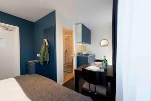Un ou plusieurs lits dans un hébergement de l'établissement Stockholm Hotel Apartments Bromma