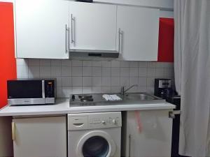 Køkken eller tekøkken på Apartments AMS Brussels Flats