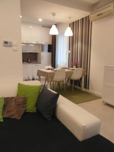 Posedenie v ubytovaní Origo Apartmanlakás