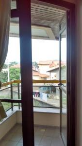 Un balcón o terraza de Temporada Ponta das Canas