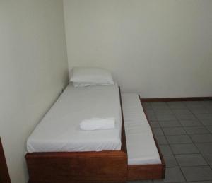 Cama o camas de una habitación en Temporada Ponta das Canas