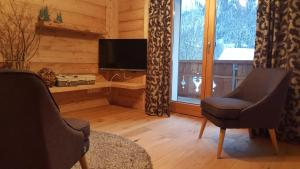 Posezení v ubytování Alpenchalet Vils