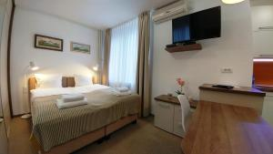 A bed or beds in a room at Dafni Apartment