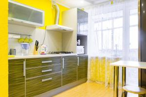 A kitchen or kitchenette at Домашний Очаг