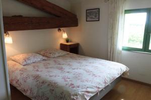 Un ou plusieurs lits dans un hébergement de l'établissement Domaine Caraman