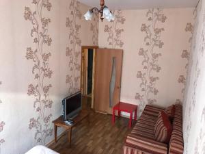 Телевизор и/или развлекательный центр в Kvartira on Pereulok Sadovy 9