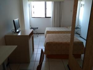 A bed or beds in a room at Apartamento/Flat na Ponta da Areia (Praia) por Temporada