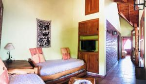 Una cama o camas en una habitación de Bungalows Santa Lucia