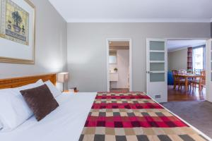 A bed or beds in a room at Mont Clare Boutique Apartments