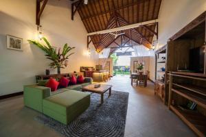 Uma área de estar em Villa Aashaya Ubud