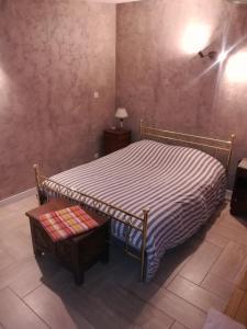 Un ou plusieurs lits dans un hébergement de l'établissement Maisonette des Viliers