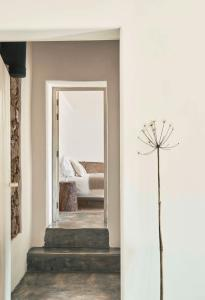 A bed or beds in a room at Casas Caiadas | Boutique Home