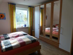 Postel nebo postele na pokoji v ubytování Auszeit am Niederrhein