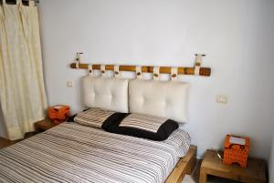 A bed or beds in a room at Beach house Morada Mistral