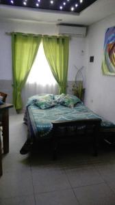 Una cama o camas en una habitación de Soñadores Viajeros