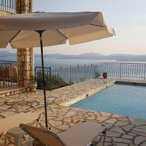 The swimming pool at or near villa Marianthi