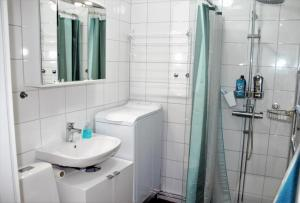 A bathroom at White Apartment by MalmoHomes