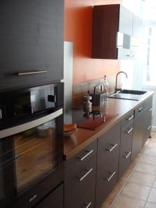 Una cocina o zona de cocina en Le Mazérien