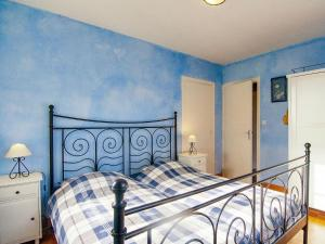 A bed or beds in a room at Beautiful House with Pool in Saint-Sulpice-d'Excideuil