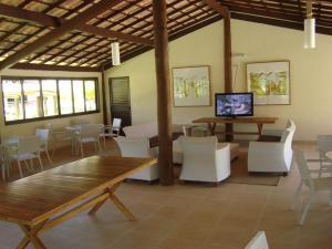 O lounge ou bar de Condominio Genipabu Club House