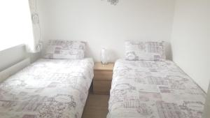 A bed or beds in a room at Belfast City Apartment