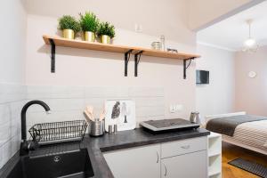 Vonios kambarys apgyvendinimo įstaigoje Berry Apartments