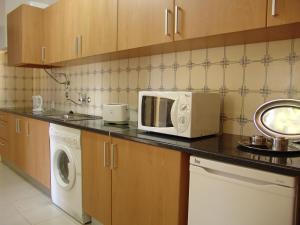 A kitchen or kitchenette at Alvor Clube Brisamar