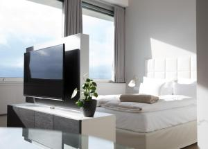 A bed or beds in a room at PhilsPlace Full-Service Apartments Vienna