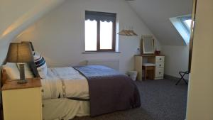A bed or beds in a room at Doolin Heights Apartment