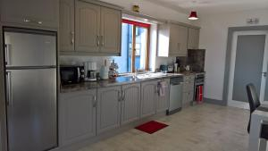 A kitchen or kitchenette at Doolin Heights Apartment