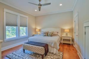 A bed or beds in a room at Gulf Dreams Home