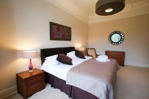 A bed or beds in a room at Eildonside
