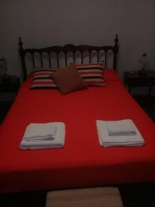 Una cama o camas en una habitación de Departamento Colonial Marcelo