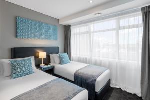 Кровать или кровати в номере Nesuto Stadium
